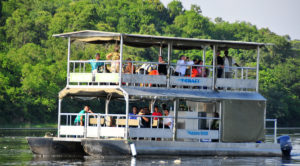 An image showing tourists on a boat cruise along River Nile.